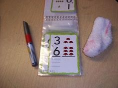 How great and yet simple! Flash cards in a photo album and a sock eraser!