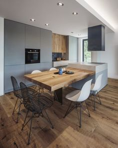 Open space kitchen with wooden floating table