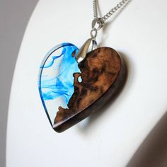 Just one of the many custom pieces that I've been working on lately.  One half is made from reclaimed wood, the other from crystal clear resin with blue swirls.