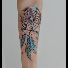 Tatouage aquarelle plume