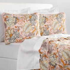 With soft coloring, these pillow shams feature a unique floral pattern in blush…