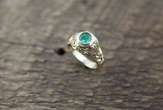 14K Yellow Gold Ring with a Colombian Emerald and Round Diamonds