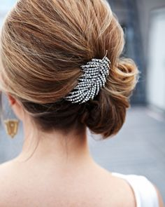 -Bridesmaid Hairstyle, maybe? Accent a side-swept 'do with a sparkling hair clip like this feathery one!
