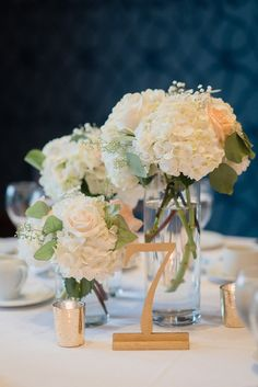 August 2015 | Milton ON | www.kjandco.ca | KJ and Co. planning, coordination and design at Stephanie & Mike's Glencairn Golf Club wedding | Photo by Jenn Kavanagh Photography | As seen on TheBlackTieBride.com | KJ and Co.'s gold table numbers and gold mercury glass votive candle holders surrounded a trio of centrepiece florals by Pocket Of Posies