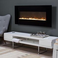Trent 50 in. Wall Mount Fireplace - Warm up any modern decor with the stylish look of the Trent Wall Fireplace. This sleek wall unit offers a flat panel design that is right at home in a...