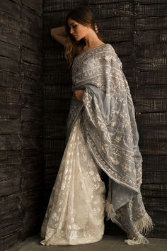 Nida Azwer offers this beautiful white and blue saree at a very reasonable cost. This saree has beautiful hand and machine embroidered all over it. It has blue pallu with frills at the edges and it comes with a silk white blouse. Pakistani Bridal, Pakistani Dresses, Indian Dresses, Indian Outfits, Formal Casual, Modern Saree, Stylish Sarees, Trendy Sarees, Elegant Saree