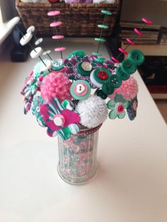 Bouquet with polymer clay flowers with button centers. Button flowers with button stems and pom poms in a sugar dispenser filled with glass beads. Button Bouquet, Button Flowers, Diy Flowers, Button Art, Button Crafts, Easy Diy Crafts, Creative Crafts, Sugar Dispenser, Chenille Crafts