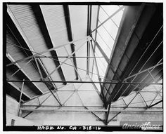 16. Detail view of saw tooth truss roof of main section,... family photo