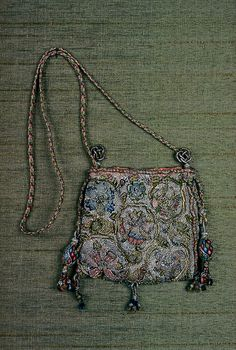 Drawstring bag Braided silk cords, two wood-core drawstring pulls, three tassels at bottom. Pink silk lining--missing in places. Some metal wires loose. Jacobean Embroidery, Embroidery Bags, Sweet Bags, Belt Purse, Costume Patterns, Handmade Purses, Boho Bags, Gold Work, Beaded Bags