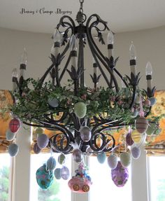 Easter Chandelier decor idea - wrap Spring themed garland in the chandelier, then hang Easter egg ornaments from the chandelier!