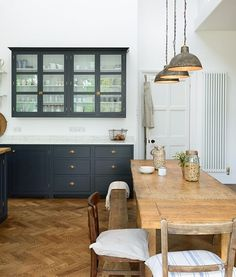 We Love This Long Refectory Table With An Assortment Of Old School Chairs And Benches In The Charming Arts Crafts Kitchen By DeVOL