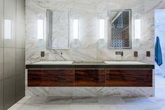 15 Insane High-End Bathroom Vanities   Dark wood stands out against light marble in this luxury bathroom vanity.
