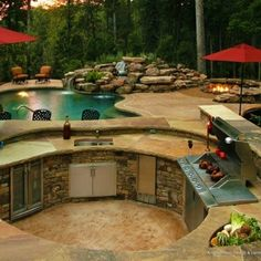Sunken kitchen in backyard with swim up pool bar.
