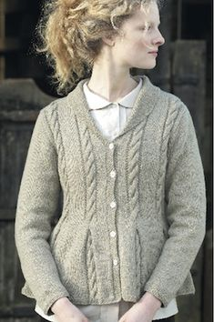 This free knit peplum jacket pattern is available at allaboutyou.com.  The pattern was first featured in Prima, September 2008.  I love the cable details and little roll collar.