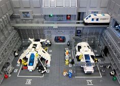 """The ground crew of Futuron Maintenance Hangar 16/17 ensure that the ships of Valor Squadron are always ready for action.""  Built for The Great Western Lego Show at STEAM 2013  Check out the video to see all the working features!!!"