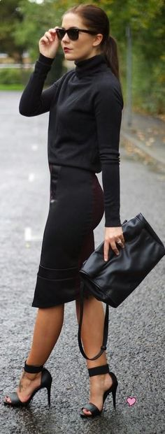 Black turtle neck shirt with pencil skirt and heels.