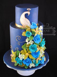 Made during a Planet Cake Course. Triple Barrel Base tier, 1.5 barrel top tier.  Handmade roses, orchids & hydrangea.