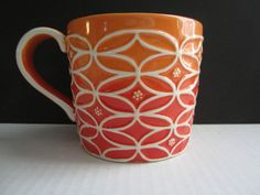 LOVE this interesting, ochre-colored Starbucks coffee mug. It has a unique white raised pattern and holds a generous 14 ounces of your favorite hot and steamy beverage!