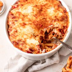 Baked ziti is classic Italian-American comfort food! Bake ziti pasta with sausage, tomato sauce, and all kinds of gooey, yummy cheeses. This easy baked ziti recipe from Simply Recipes is always a hit! Casserole Recipes, Pasta Recipes, Easy Baked Ziti, Ziti Recipe, Dinner Bell, Sausage Pasta, Simply Recipes, Feeding A Crowd, Classic Italian