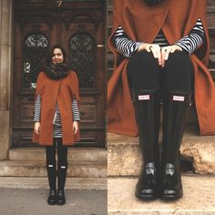 Get this look: http://lb.nu/look/7138664  More looks by Marijana M: http://lb.nu/kenguri  Items in this look:  Yoins Cape, Choies Clutch, Hunter Rain Boots, Sheinside Striped Dress, Style Moi Rings   #chic #retro #street #cape #trendy #orange #blackboots #rainboots #hunter