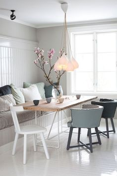 Fitted seating. Norwegian style. Japanese inspired blossom. Light cluster. Grey/white. Mis-match chairs. Reclaimed door up-cycled table.
