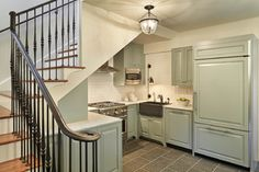 What if the kitchen recessed under the stair.   Not enough room probably.   Touch of Normandy - traditional - kitchen - seattle - by Gelotte Hommas Architecture