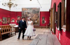 The art galleries offer the perfect setting for intimate wedding photos at Bristol Museum.   The Wedding of Rachel and Tom (Photography by Rebecca Faith).