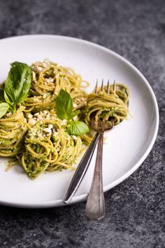 This simple recipe for oil free pesto is totally vegan, and features basil, cashew nuts and avocado. It's a super simple, staple dinner that's whipped up in no time!