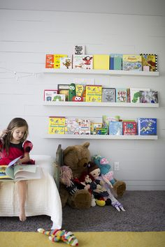 What a brilliant idea! A book wall for a child's room, featured in Kelly Moore Clark's Louisiana home and highlighted by @Elsie Larson of A Beautiful Mess. /ES