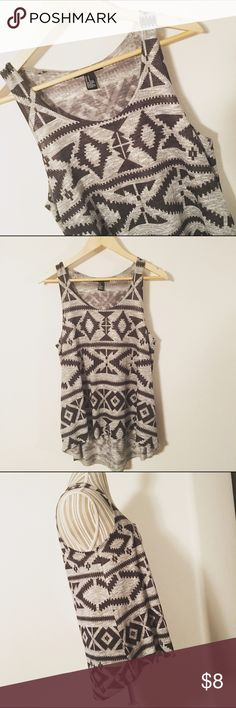 Tribal print tank Gray and black tribal print tank. Longer in back. True to F21 sizing. Never machine dried. Excellent condition. Great layering piece! Forever 21 Tops