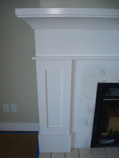 White Fireplace mantle and marble face