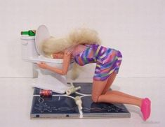 Hangover Barbie...Laurie, this one can go next to your barefoot and pregnant barbie!! LOL