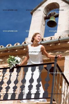 http://www.photaki.com/picture-bride-standing-on-balcony_1323557.htm