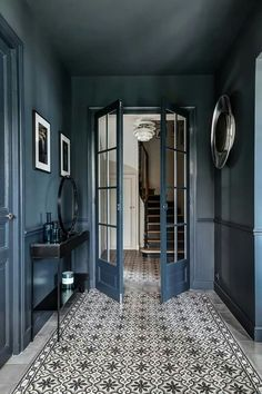 Dark hallway inspiration with tiled floorsYou can find The doors and more on our website.Dark hallway inspiration with tiled floors Interior Design Blogs, Diy Interior, Hall Interior, Interior Colors, Luxury Interior, Hallway Inspiration, Interior Inspiration, Blog Design Inspiration, Dark Hallway