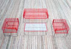 peoples industrial design office // mesh sofa // red stainless glass cofee table