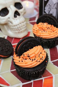 Don't be frightened, but there's a surprise lurking inside. These chocolate cupcakes have a Halloween Oreo in the bottom with matching orange cream cheese frosting! Halloween Oreos, Halloween Baking, Halloween Chocolate, Halloween Desserts, Halloween Food For Party, Halloween Cakes, Halloween 2020, Cupcake Cream, Cupcakes With Cream Cheese Frosting