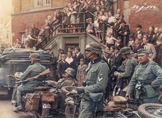 Wehrmacht Soldiers outside a building with people posing for the cameras. We can only guess where & when exactly. As to why...well that's a mystery as well. I wonder what was going through their minds at that moment.
