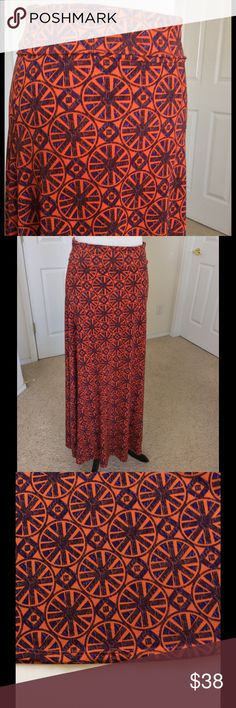 LuLaRoe Maxi Skirt EUC Gorgeous deep bluish medallion print on a burnt orange background. Stretchy & soft. Fold over waist allows you to adjust lengths. Can also be worn as a dress. Excellent used condition. Loose thread on hem shown in photo. Hem is intact. 96% polyester 4% spandex. Machine wash. Hang dry  🎀Bundle discount  🚭Smoke free home 🚫No trades please  😍 Thank you for shopping with me. Please ask all questions before purchase LuLaRoe Skirts Maxi