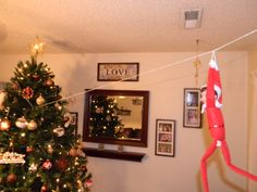 Frisbee zip lining. A string placed from the curtain rod to the Christmas tree.