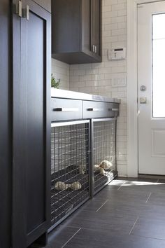 Custom built in dog bed / crate in this mudroom makes for a tidy, pet friendly home.  The dog cage is built with stainless steel grille.