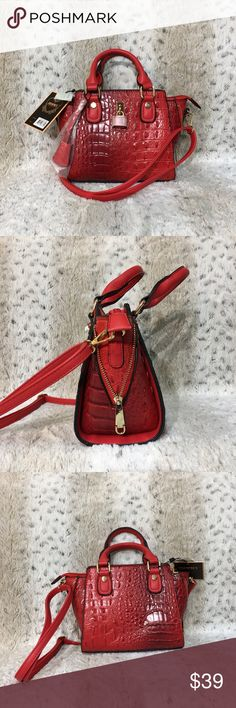 """Red Crossbody Bag This beautiful red croc-embossed faux leather Crossbody bag is entirely too cute! Comes with two short handles and also a removable/adjustable Crossbody strap. Purse Dimensions: 8""""H x 8.5""""W @ Bottom & 11""""W @ Top x 4.5""""D Short handles 3.5"""" Appox drop. Adjustable strap fully extended has Approx 32"""" drop. Zip Closer. Gold-toned hardware. Interior includes main compartment, one zip pocket & 2 slip pockets. NWT Bags Crossbody Bags"""