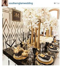 Dramatic Art Deco inspired tablescape with black and gold accents