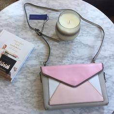 "final price Rebecca Minkoff Marlowe Bag New, never used. Retails for $265. Purchased for $165 + 8.85% NYC taxes & was hoping to resell for same price (including 20% posh fee). This colorblock envelop style bag can be used as as Crossbody or clutch. It has expandable side zippers. The strap can be removed. Comes with a dust bag.  10.75""W x 8""H x 2""D Genuine leather 25"" adjustable detachable shoulder strap drop Flap closure w/ magnetic snap & exterior slip pocket w/ magnetic snap closure…"