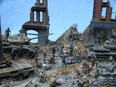 Russian armor and troops in a bombed out city.
