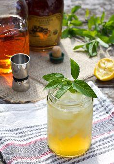 champ whiskey sour  1 oz. bourbon  1 oz. apple brandy 3/4 oz. simple syrup 3/4 oz. fresh lemon juice mint for garnish