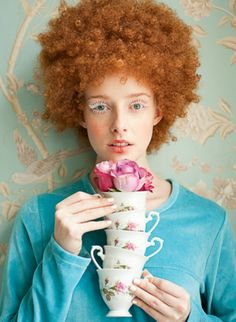 Red afro hair, china teacups and roses