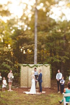 gold ceremony backdrop - photo by Kelly Maughan Photography http://ruffledblog.com/north-carolina-wedding-sourced-from-antique-shops #ceremonies #backdrops