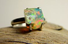 This is a beautiful natural, raw Ethiopian Welo Opal stone set a hand made sterling silver double shank..
