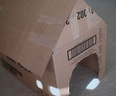 How to Make a Cardboard Doghouse.