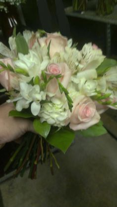 Have your Bridesmaids hold onto this beautiful bouquet! americasflorist.com